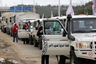 TOPSHOT-SYRIA-CONFLICT-AID-MADAYA
